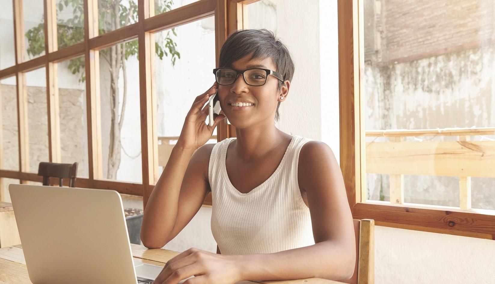 Close Up Portrait Of Cute Dark Skinned Female Entrepreneur Sitti